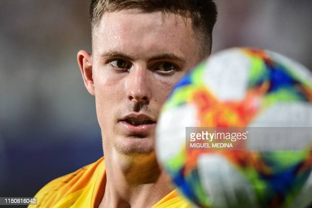 England's goalkeeper Dean Henderson eyes the ball during the Group C match of the U21 European Football Championships between England and France on...