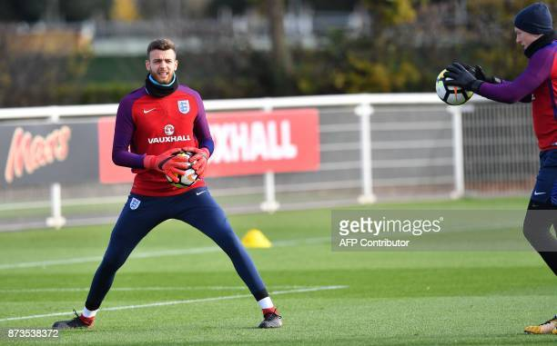 England's goalkeeper Jack Butland and England's goalkeeper Jordan Pickford take part in an England national football team training session at...