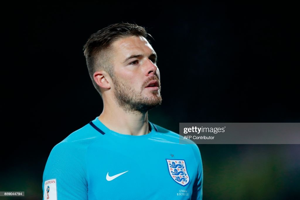 England's goalkeeper Jack Butland leaves the pitch after the final whistle during the 2018 FIFA World Cup European Qualifying football match between Lithuania and England at the LFF Stadium in Vilnius on October 8, 2017. / AFP PHOTO / Adrian DENNIS