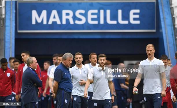 England's goalkeeper Joe Hart Adam Lallana coach Roy Hodgson and teammates inspect the Stade Velodrome in Marseille France 10 June 2016 England will...