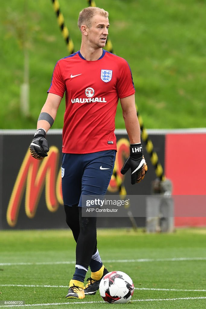 England's goalkeeper Joe Hart attends a training session at St George's Park in Burton-on-Trent on August 29, 2017, as part of an England football team media day ahead of their 2018 FIFA World Cup qualifier matches against Malta on September 1 and Slovakia on September 4. / AFP PHOTO / Paul ELLIS / NOT