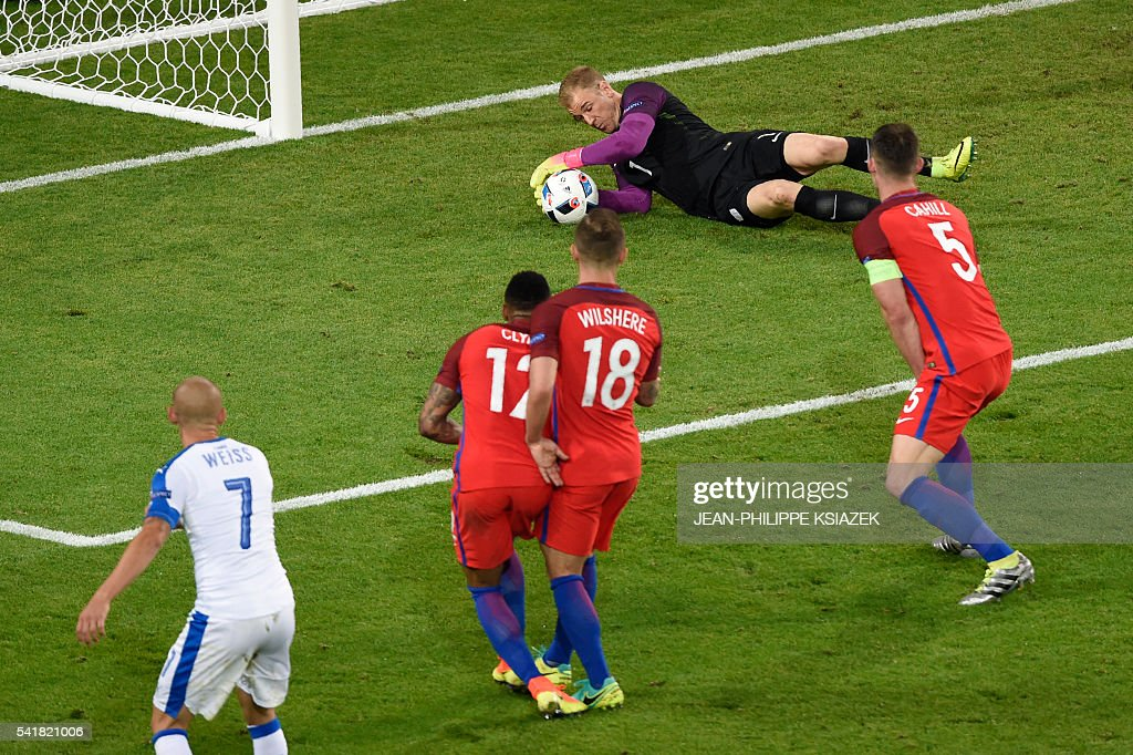 TOPSHOT - England's goalkeeper Joe Hart (C) dives for the ball during the Euro 2016 group B football match between Slovakia and England at the Geoffroy-Guichard stadium in Saint-Etienne on June 20, 2016. / AFP / JEAN