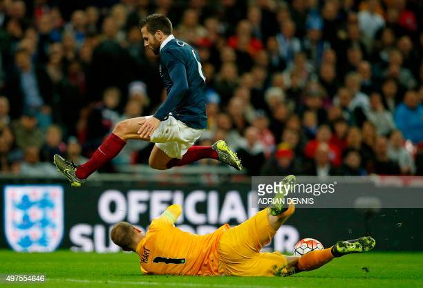 England's goalkeeper Joe Hart dives to save an attempted shot by France's midfielder Yohan Cabaye during the friendly football match between England...