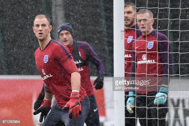 England's goalkeeper Joe Hart England's striker Jamie Vardy England's goalkeeper Jack Butland and England's goalkeeper Jordan Pickford attend a...