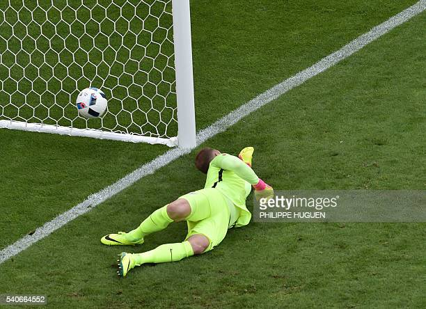 England's goalkeeper Joe Hart fails to save the ball during the Euro 2016 group B football match between England and Wales at the Bollaert-Delelis...