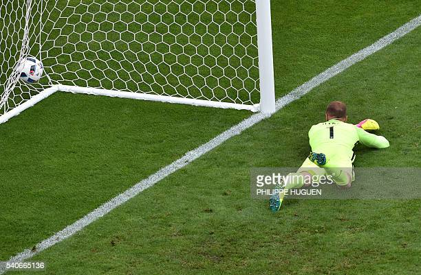 TOPSHOT England's goalkeeper Joe Hart fails to save the ball during the Euro 2016 group B football match between England and Wales at the...