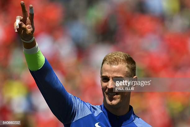 England's goalkeeper Joe Hart gestures ahead the Euro 2016 group B football match between England and Wales at the BollaertDelelis stadium in Lens on...