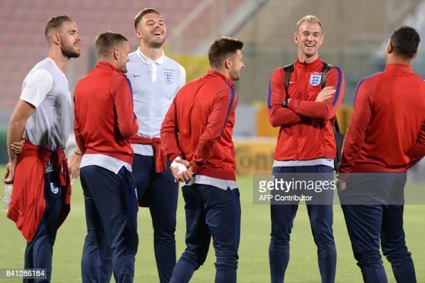 England's goalkeeper Joe Hart jokes with teammates as they tour the National Stadium in Malta's Ta' Qali village, on the eve of the 2018 FIFA World...