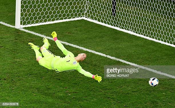 TOPSHOT England's goalkeeper Joe Hart jumps for the ball during the Euro 2016 group B football match between England and Russia at the Stade...