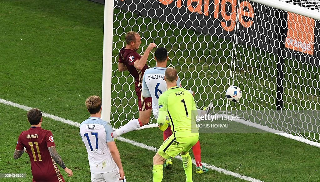 TOPSHOT - England's goalkeeper Joe Hart (C) looks at the ball going into his net during the Euro 2016 group B football match between England and Russia at the Stade Velodrome in Marseille on June 11, 2016. / AFP / BORIS