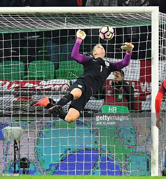 England's goalkeeper Joe Hart makes a save during the World Cup 2018 football qualification match between Slovenia and England in Ljubljana on...
