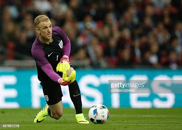 England's goalkeeper Joe Hart passes the ball during the friendly football match between England and Portugal at Wembley stadium in London on June 2...