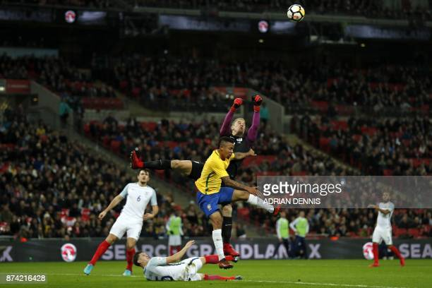 TOPSHOT England's goalkeeper Joe Hart punches the ball clear during the international friendly football match between England and Brazil at Wembley...