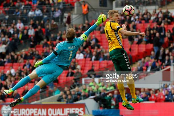 England's goalkeeper Joe Hart vies for the ball with Lithuania's midfielder Vykintas Slivka during the World Cup 2018 qualification football match...