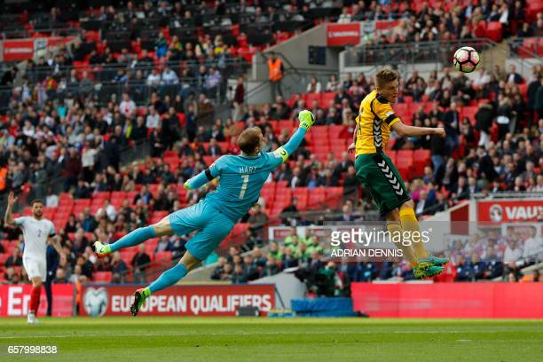 TOPSHOT England's goalkeeper Joe Hart vies for the ball with Lithuania's midfielder Vykintas Slivka during the World Cup 2018 qualification football...