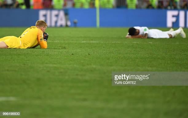 TOPSHOT England's goalkeeper Jordan Pickford and England's forward Marcus Rashford react at the end of the Russia 2018 World Cup semifinal football...