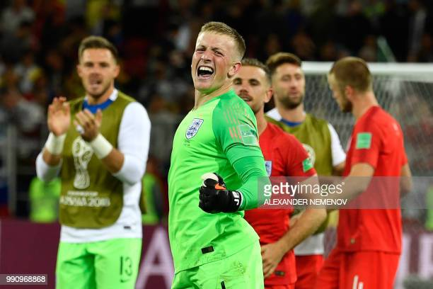 TOPSHOT England's goalkeeper Jordan Pickford and teammates celebrate after winning the penalty shootout at the end of the Russia 2018 World Cup round...