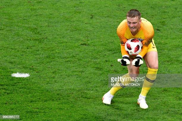 England's goalkeeper Jordan Pickford catches the ball during the Russia 2018 World Cup semifinal football match between Croatia and England at the...