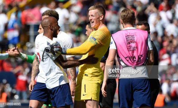 England's goalkeeper Jordan Pickford celebrates with teammates their victory after the UEFA Nations League third place football match between England...