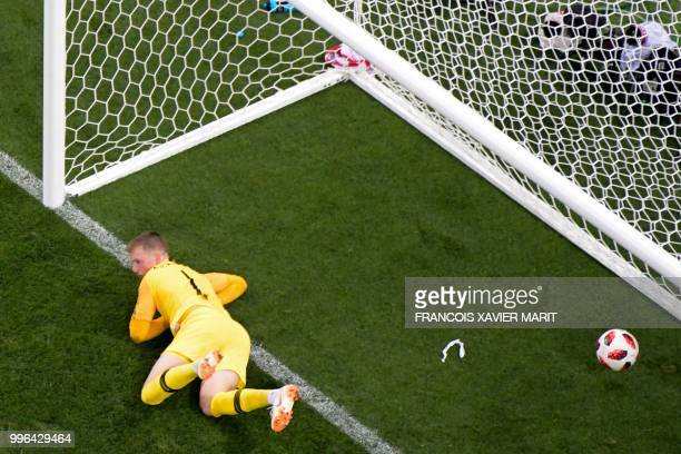 TOPSHOT England's goalkeeper Jordan Pickford concedes a goal during the Russia 2018 World Cup semifinal football match between Croatia and England at...