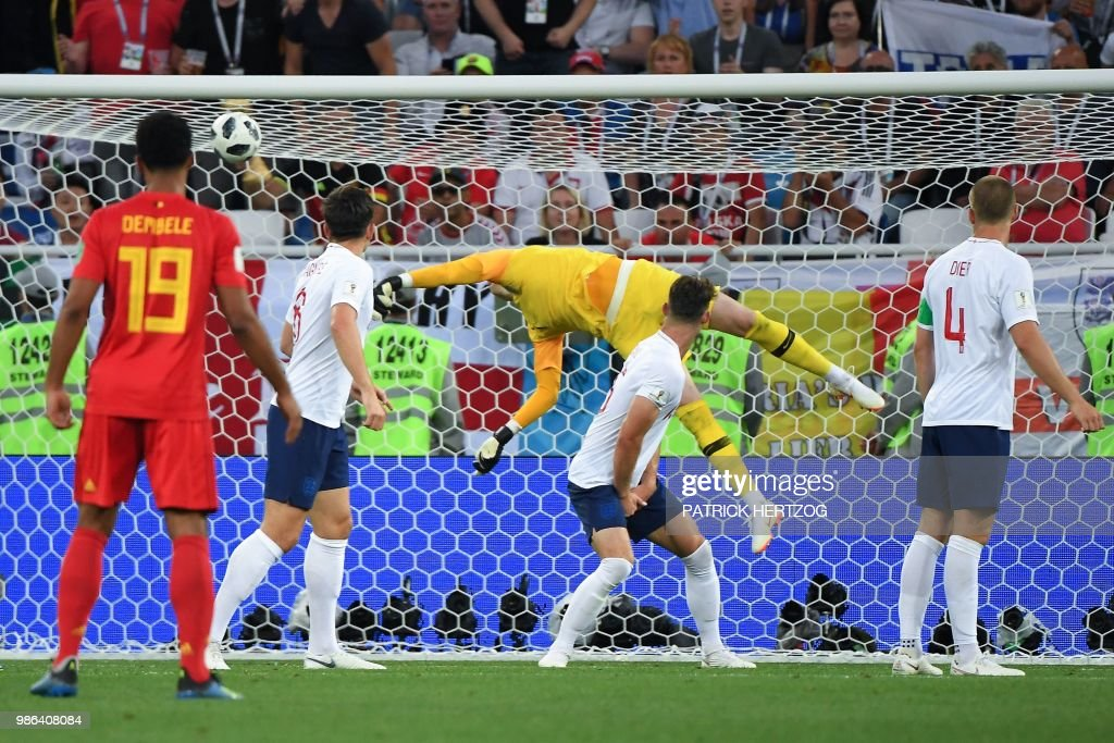 TOPSHOT - England's goalkeeper Jordan Pickford concedes the opening goal during the Russia 2018 World Cup Group G football match between England and Belgium at the Kaliningrad Stadium in Kaliningrad on June 28, 2018. (Photo by Patrick HERTZOG / AFP) / RESTRICTED