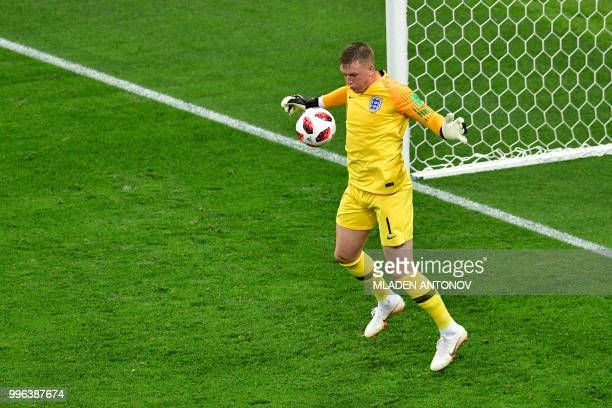 England's goalkeeper Jordan Pickford controls the ball during the Russia 2018 World Cup semifinal football match between Croatia and England at the...