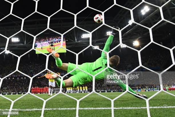 England's goalkeeper Jordan Pickford jumps to catch the ball as Colombia's forward Carlos Bacca misses his penalty kick during the penalty shootout...