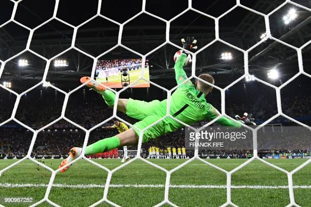 TOPSHOT England's goalkeeper Jordan Pickford jumps to catch the ball as Colombia's forward Carlos Bacca misses his penalty kick during the penalty...