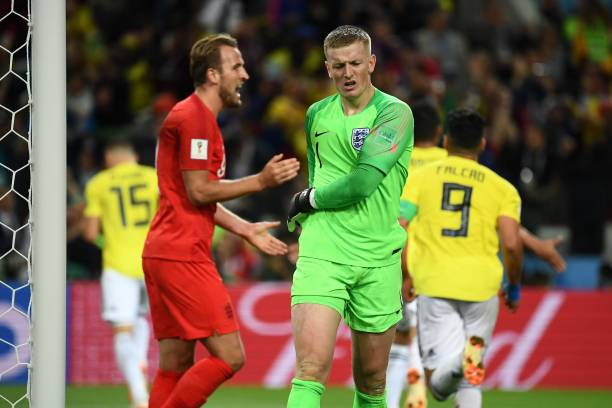 fb0ec69da England s goalkeeper Jordan Pickford (C) reacts after Colombia s defender  Yerry Mina (unseen)