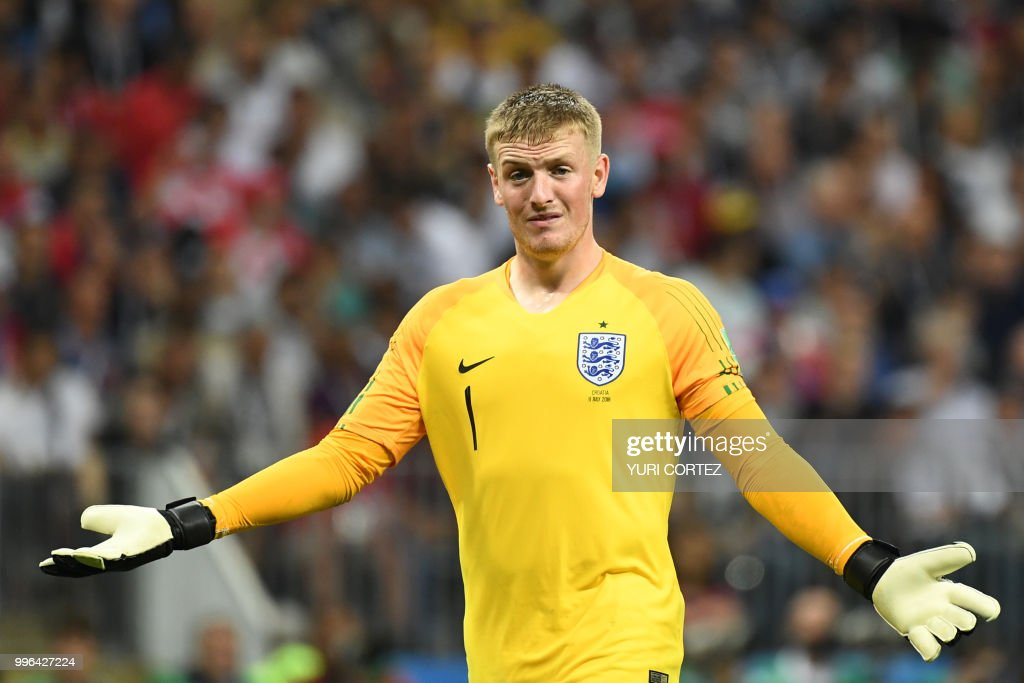 England's goalkeeper Jordan Pickford reacts after Croatia scored during the Russia 2018 World Cup semi-final football match between Croatia and England at the Luzhniki Stadium in Moscow on July 11, 2018. (Photo by YURI CORTEZ / AFP) / RESTRICTED