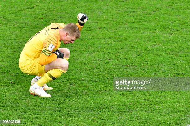 England's goalkeeper Jordan Pickford reacts after losing the Russia 2018 World Cup semifinal football match between Croatia and England at the...
