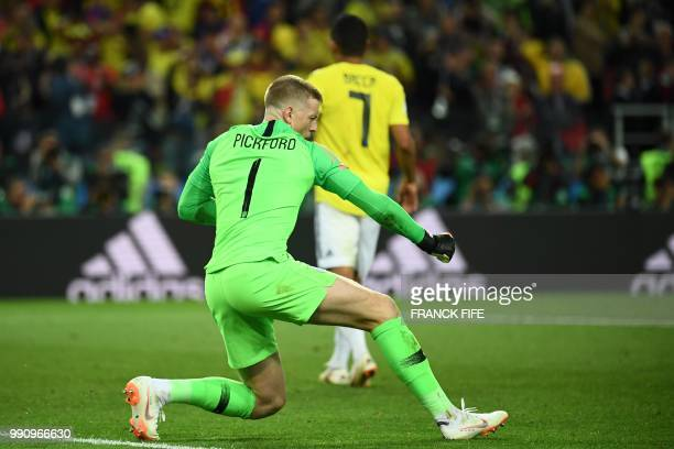 TOPSHOT England's goalkeeper Jordan Pickford reacts after stopping the penalty kick of Colombia's forward Carlos Bacca during the penalty shootout of...
