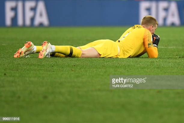 England's goalkeeper Jordan Pickford reacts at the end of the Russia 2018 World Cup semifinal football match between Croatia and England at the...