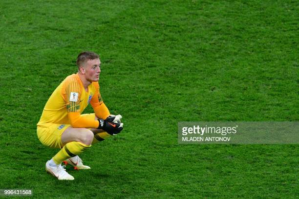 England's goalkeeper Jordan Pickford reacts during the Russia 2018 World Cup semifinal football match between Croatia and England at the Luzhniki...