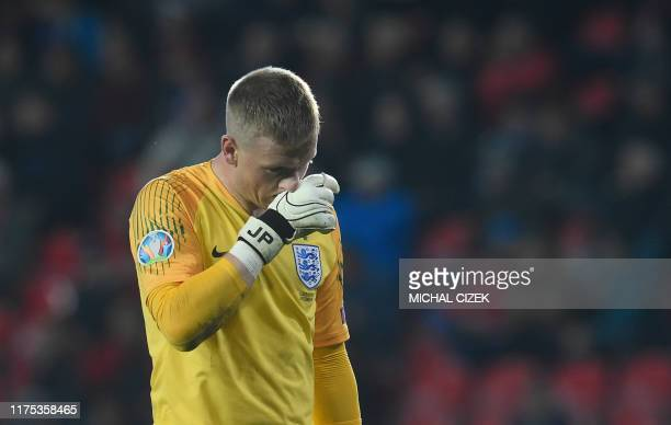 England's goalkeeper Jordan Pickford reacts during the UEFA Euro 2020 qualifier Group A football match Czech Republic v England at the Sinobo Arena...