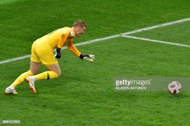 England's goalkeeper Jordan Pickford runs for the ball during the Russia 2018 World Cup semifinal football match between Croatia and England at the...