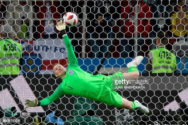 England's goalkeeper Jordan Pickford stops Colombia's forward Carlos Bacca's shot during the penalty shootout at the end of the Russia 2018 World Cup...
