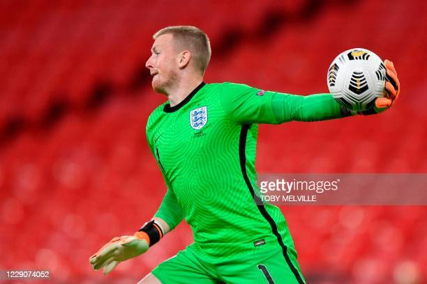 England's goalkeeper Jordan Pickford throws the ball during the UEFA Nations League group A2 football match between England and Denmark at Wembley...