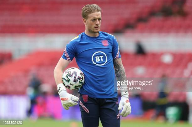 England's goalkeeper Jordan Pickford warms up ahead of the international friendly football match between England and Romania at the Riverside Stadium...