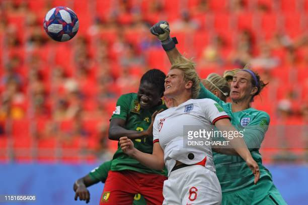 TOPSHOT England's goalkeeper Karen Bardsley boxes the ball in front of Cameroon's forward Alexandra Takounda and England's defender Millie Bright...