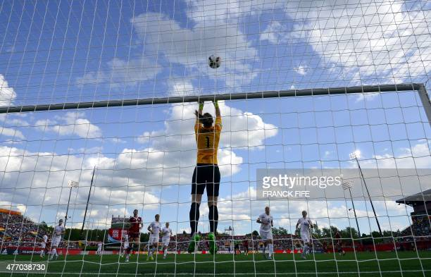 England's goalkeeper Karen Bardsley jumps for the ball during a Group F match at the 2015 FIFA Women's World Cup between England and Mexico at...