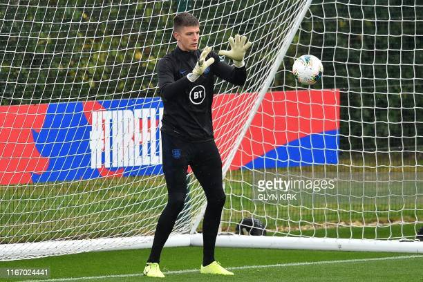 England's goalkeeper Nick Pope attends an England team training session at Staplewood Campus in southampton southern England on September 9 ahead of...