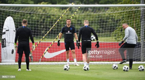 England's goalkeeper Nick Pope England's goalkeeper Jack Butland and England's goalkeeper Jordan Pickford attends a open training session at St...