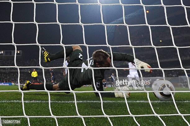 England's goalkeeper Robert Green fails to block a shot by US midfielder Clint Dempsey during their Group C first round 2010 World Cup football match...