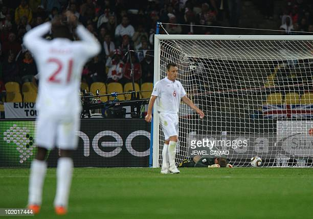 England's goalkeeper Robert Green reacts after US midfielder Clint Dempsey scored against England during the Group C first round 2010 World Cup...