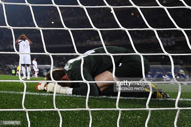 England's goalkeeper Robert Green reacts to failing to block a shot by US midfielder Clint Dempsey during their Group C first round 2010 World Cup...