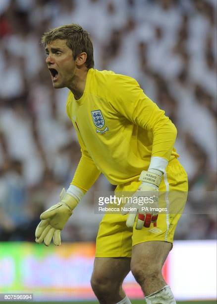 England's goalkeeper Robert Green shouts instructions.