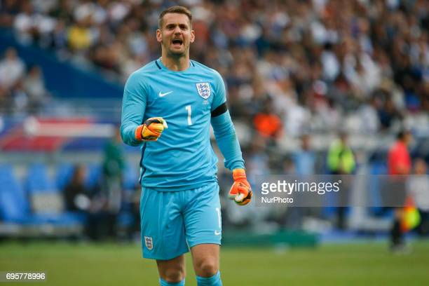 England's goalkeeper Tom Heaton reacts during the international friendly football match between France and England at The Stade de France Stadium in...