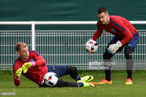 England's goalkeepers Joe Hart and Tom Heaton attend a training session at the Bourgogne stadium in Chantilly on June 26 during the Euro 2016...
