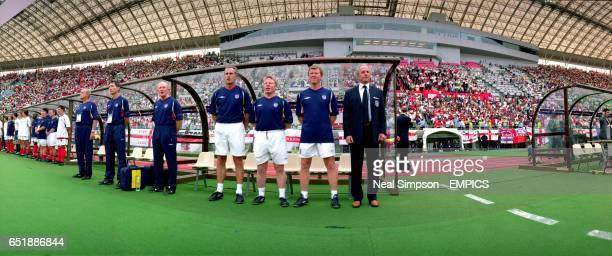 England's goalkeeping coach Ray Clemence, coach Sammy Lee, coach Steve McClaren and manager Sven Goran Eriksson line up for the National anthem prior...
